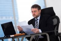 Man at desk with computer