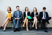 Row of male and female job seekers