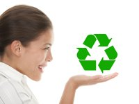 Young woman holding recycling image in her hand