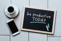 "A chalkboard with ""be productive today"" written in chalk"