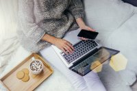 Image of woman relaxing while on laptop