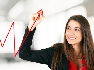 A young businesswoman showing growth on a chart